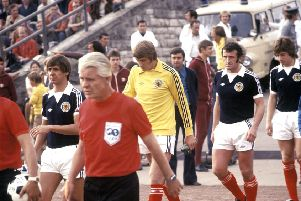 David Stewart (yellow jersey) alongside Scotland team-mates Don Masson, Danny McGrain and Willie Donachie ahead of the match against East Germany in East Berlin in 1977. Picture: SNS
