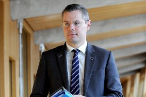 Derek Mackay delivers his statement regarding business rates/income tax at Scottish Parliament today. Picture: Lisa Ferguson.