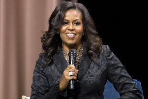 Michelle Obama's book Becoming has been flying off the shelves despite left-wing claims of 'vapid liberalism' (Picture: Jose Luis Magana/AP)
