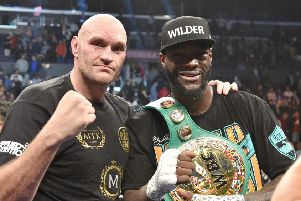 Tyson Fury, left, and Deontay Wilder share a photo afterwards. Picture: Lionel Hahn/PA