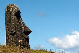 Easter Island's society collapsed after the people living there stripped it of trees (Picture: Martin Bernetti/AFP/Getty Images)