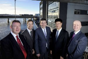 L to R: Norman McLennan, COES; Councillor John Alexander; Jamie Hepburn MSP; Hong Chong, president, COES; and Neil Francis, director, Scottish Development International. Picture: Colin Hattersley