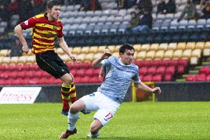 Blair Spittal strikes to fire Partick Thistle ahead. Pic: SNS/Bruce White