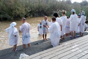 Pilgrims line up for baptism on the banks of the River Jordan at Qasr al-Yahud. Picture: HALO Trust