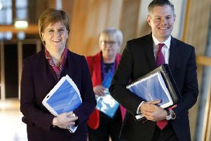 Changes to the tax bands introduced by finance secretary Derek Mackay, pictured right next to First Minister Nicola Sturgeon, will see more Scots paying the top band of tax. Picture: PA Wire