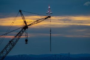 Festive Christmas Tree on top of a crane at  Briggs Marine in Burntisland, Fife. Picture: SWNS