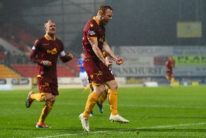 Danny Johnson celebrates his goal for Motherwell. Pic: SNS/Craig Foy