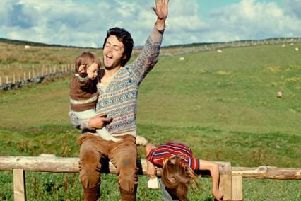 Linda McCartney captured this image of her husband Paul with children Mary and Heather in Campbeltown, Argyll, in 1970.