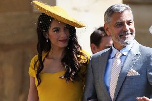 Amal and George Clooney will return to Edinburgh next year. Picture: PA