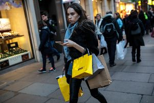 While many shoppers still use their fair share of bags on the high street, a decline in sales of single-use plastic carrier bags - especially in supermarkets - has hit charities. Picture: Getty