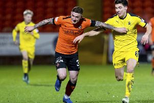 Fraser Aird, left, holds off Falkirk's Ruben Summut during Dundee United's victory over the Bairns at Tannadice. Picture: SNS