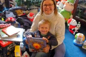 Julie Muir and her three year old son Rhys pictured in her mother's sitting room, which has been taken over with'toys and clothes donated by wellwishers after the fire at the family home destroyed their possessions including'Christmas presents. Picture: Moira Kerr.