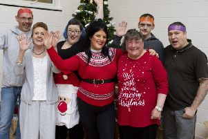 Single mum Taylor Barnes, 21, who dreaded spending Christmas Day alone organised a special dinner for 70 in Greenock. Picture: SWNS