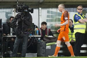 Dundee United's Willo Flood leaves the pitch after being sent off in his side's play-off semi-final. Picture: SNS