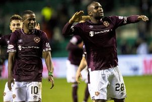 Hearts defender Clevid Dikamona, right, celebrates at full-time. Picture: SNS