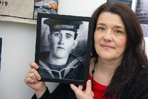 Sharon Smith, great niece of Malcolm Thomson with his picture.