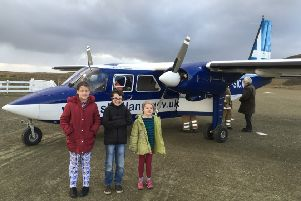 (L-R) Grace Parnaby, Lewis Wright-Stanners and Freyja Parnaby get ready to fly to their swimming lesson from their home on Fair Isle. Picture: SWNS