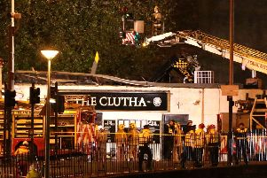 Police and Scottish Fire and Rescue services at the scene of a helicopter crash at the Clutha Bar in Glasgow in 2013. Picture: Andrew Milligan/PA Wire