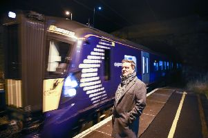 Robert Keenan at Musselburgh with one of the new Hitachi trains. Picture: Jon Savage