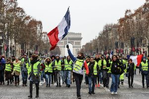 """The """"Yellow Vests"""" (Gilets Jaunes) movement in France originally started as a protest about planned fuel hikes but has morphed into a mass protest against President's policies and top-down style of governing. Picture: Valery HACHE / AFP/Getty Images."""