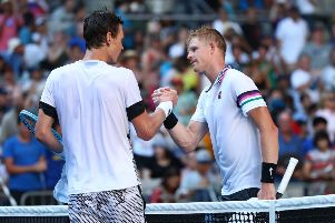 Kyle Edmund with Tomas Berdych after their Australian Open first-round match. Picture: Getty Images