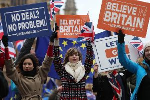 Pro-Brexit supporters hold up placards outside parliament on the day of the 'meaningful vote'. Picture: AFP/Getty