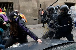 Catalan regional police clash with pro-independence protesters as the Spanish Cabinet meets in Barcelona last month (Picture: Josep Lago/AFP/Getty)