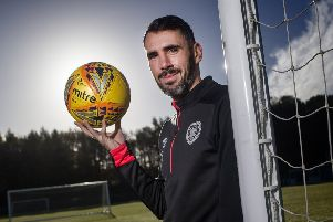 Michael Smith has been in good form for Hearts this season. Pic: SNS