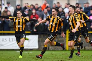 Talbot players celebrate after Craig McCracken's (centre) winner. Pic: SNS/Craig Williamson