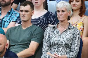 Jamie and Judy Murray watch Andy in action in Melbourne last week but now she is looking for money for her centre. Photograph: Cameron Spencer/Getty Images