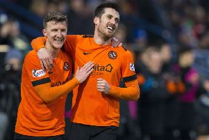 Dundee United's Callum Booth doubles the lead for his side. Pic: SNS/Bruce White