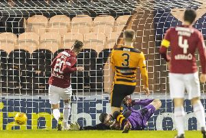 St Mirren's Cody Cooke scores St. Mirren's first. Pic: Roddy Scott/SNS