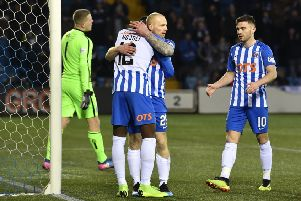 Chris Burke get s hug from team-mate Mikael Ndjoli to celebrate his goal/ Picture: SNS.