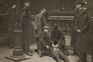 David Kirkwood, later an MP, lies prone after being hit by police, while future Communist MP Willie Gallacher is arrested (Picture: National Library of Scotland)