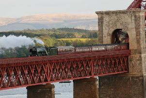 Flying Scotsman crossing the Forth Bridge in 2016 on its first Scottish visit since restoration. Picture: Myles Fitt