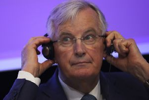 European Union chief Brexit negotiator Michel Barnier adjusts his headphones during a debate on Brexit at the Charlemagne building in Brussels. Picture: AP Photo/Francisco Seco