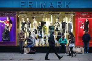 Customers wait with their purchases outside Primark's flagship store on Oxford Street. Picture: Peter Macdiarmid/Getty Images