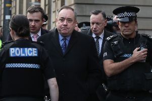 Alex Salmond leaves Edinburgh Sheriff Court after he was arrested and charged by police. Picture: Andrew Milligan/PA