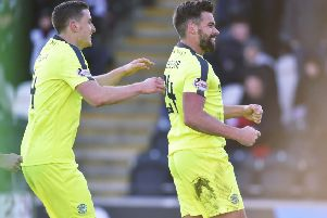 Darren McGregor, right, celebrates scoring Hibs' second, and decisive, goal in their 3-1 victory over St Mirren. Picture: SNS.