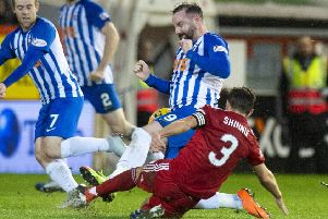 Kris Boyd was sent off for this challenge on Graeme Shinnie. Picture: SNS