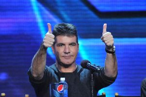 If you think you can get two thumbs up from Simon Cowell, you should audition to become an X Factor contestant (Photo: Shutterstock)