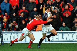 John Leslie breaks clear to score Scotland's opening try after only 10 seconds in the 33- 20' victory over Wales in the Five Nations at Murrayfield in 1999.