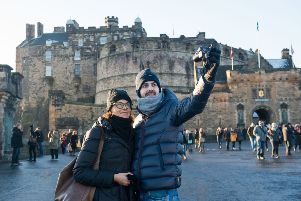 Visitors at Edinburgh Castle, who may soon face a �2 hotel levy. Picture: Ian Georgeson