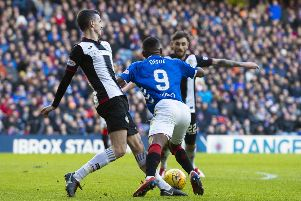 Rangers' Jermain Defoe goes down under a challenge and earns his side their second penalty of the afternoon. Picture: SNS