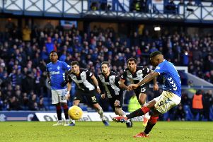 Jermain Defoe strokes home his penalty to give Rangers a 3-0 lead over St Mirren at Ibrox on Saturday. Picture: SNS.