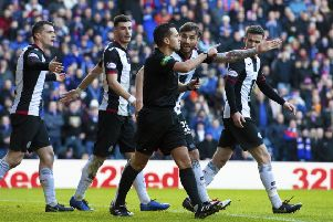 St Mirren players appeal to referee Andrew Dallas after Rangers are awarded their second penalty of the afternoon. Picture: SNS