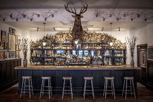 The Flying Stag public bar in The Fife Arms, where a stage leaps out over the bar and paintings of local characters decorate the walls. Picture: Sim Canetty-Clarke