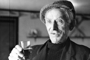 South Uist man John MacIsaac with a glass of Highland Nectar whisky, bottles of which he liberated from the SS Politician  when she went aground in 1941. PIC: TSPL.