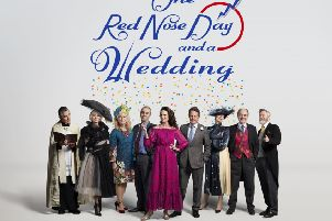 A photo of the cast of Four Weddings And A Funeral (left to right) Rowan Atkinson (Father Gerald), Kristin Scott Thomas (Fiona), Sophie Thompson (Lydia), John Hannah (Matthew), Andie MacDowell (Carrie), Hugh Grant (Charles), Anna Chancellor (Henrietta), David Haig (Bernard), James Fleet (Tom) reunited for One Red Nose Day And A Wedding. Picture: Comic Relief/PA Wire