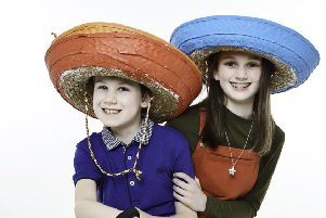 Chloe Lowther, 11, and her brother Oscar, nine, are featuring in this yea's national Wear A Hat Day campaign by the Brain Tumour Research charity
